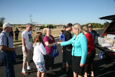 Congresswoman and Republican Candidate for Governor Mary Fallin gives words of encouragement as OKC Tea Partiers do their final registration to board buses for Washington D.C.